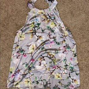 Silky, silver with colorful flowers halter top.